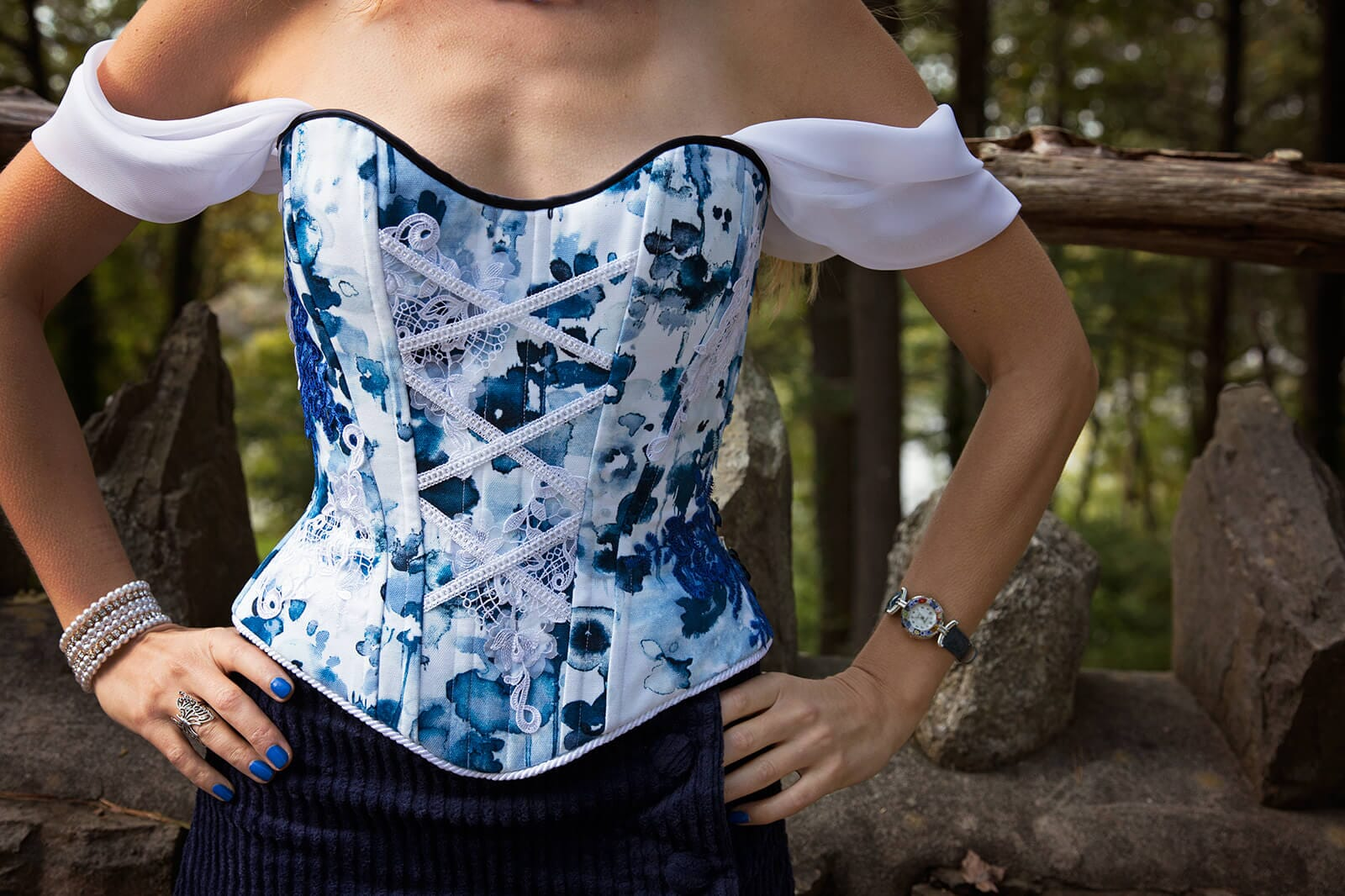 Woman in Off-Shoulder Corset with Stones and trees